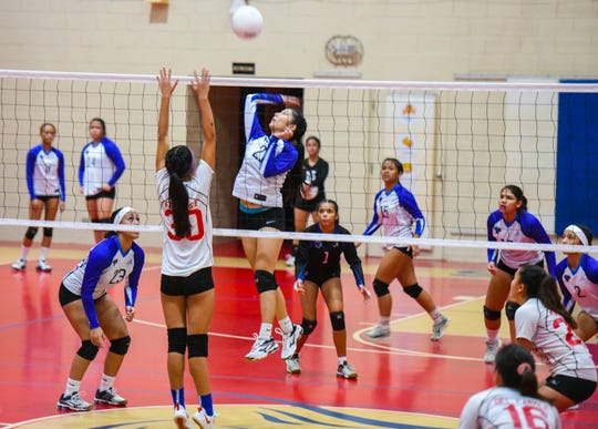 Players of the Saint Paul Warriors and St. John's Knights compete against each other during their Shieh Preseason High School Girls Volleyball Tournament matchup at St. John's Dale Jenkins Gym in Tamuning on Thursday, Aug. 15, 2019. The final score: Warriors, 26 and Knights, 30.