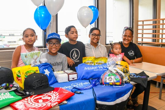 Make-A-Wish Guam and Commonwealth Northern Mariana Islands wish recipient, Patrick Arriola, 15, wears his MAW cap as he is gathered with family members during a send-off ceremony celebrated at the McDonald's of Guam in Harmon on Thursday, Aug. 15, 2019. Arriola, a Okkodo High School sophomore, is scheduled to undergo a kidney transplant in Texas. The kidney to donated will be provided by his step-father, Peter Atalig, who insisted the donated organ be his, said Arriola's mother, Rosemary Atalig. Arriola's wish was to be accompanied by his family on his journey to Texas for the transplant. Through the efforts of MAW Guam, he will joined by his mother, three sisters and an adult cousin, to meet up with his father who flew ahead to Texas to prepare for the operation.