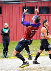 Guam's Brian Johnson works through an upper-body challenge at the North American OCR Championship held Aug. 10 in Vermont.
