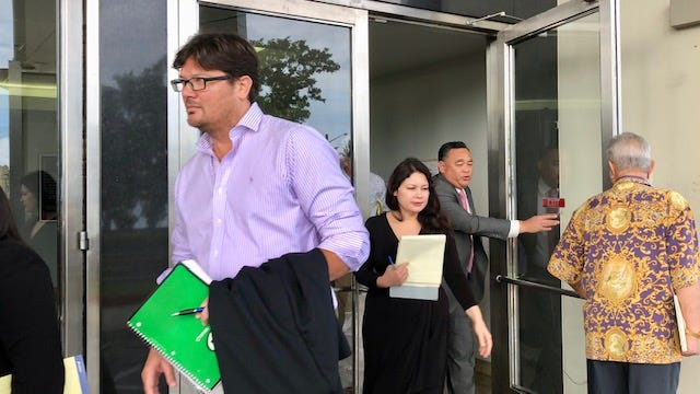 Attorneys for Guam's clergy sex abuse plaintiffs and defendants exit the U.S. District Court of Guam building on Aug. 16, 2019 after a joint status hearing, a day after the deadline to file claims in the Archdiocese of Agana's bankruptcy case.