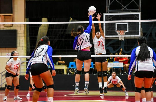 Saint Paul Warriors' Monica Giger (24) and St. John's Knights' Jadyn Palomares square off at the net during a game in the Shieh Preseason High School Girls Volleyball Tournament at St. John's Dale Jenkins Gym in Tamuning on Thursday, Aug. 15, 2019.  The IIAAG Girls High School Volleyball season kicks off tonight.