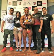 Xavier Reyes, center, takes a picture with his visiting family from Guam at the 2019 Central Japan Bodybuilding Federation's Friendship Cup Tokyo, held  July in Akishima, Japan. Reyes is active duty military stationed in Japan.