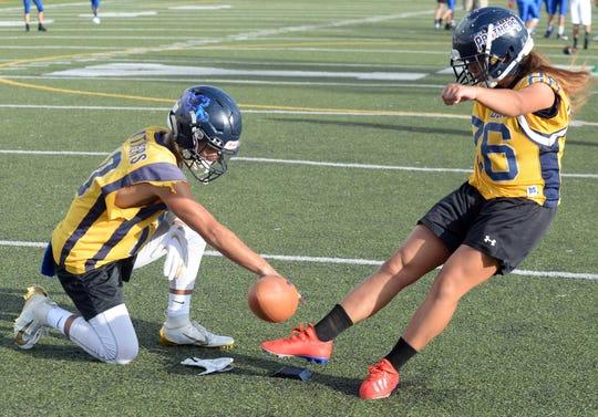 Guam High School's Ali Shimazaki follows through on a kick during a football combine held at Yokota High School in Japan Aug. 13-15.