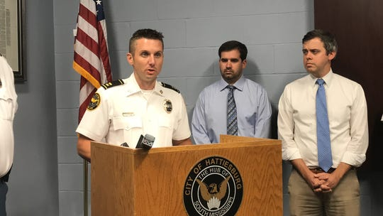 Hattiesburg Police Capt. Branden McLemore talks about recent gang activity that led to two recent homicides during a news conference Friday, Aug. 16, 2019, at Hattiesburg Police Department. Also pictured, from left, are HPD spokesman Ryan Moore and Mayor Toby Barker.