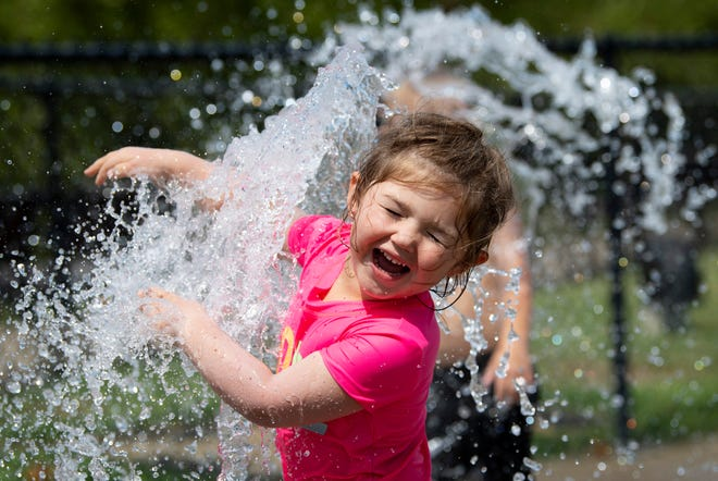 Kaizlee Sales, 2, of Morganfield, Ky., isn't shy about getting wet in Henderson's riverfront fountain Friday afternoon. Temperatures are going to climb into the 90s this weekend and the local fountains might be the ticket to riding out the heat wave.