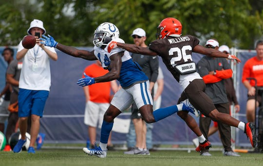 Indianapolis Colts wide receiver Zach Pascal (14) reaches for the ball as Cleveland Browns cornerback Greedy Williams (26) defends during their joint practice at Grand Park in Westfield on Thursday, August 15, 2019.