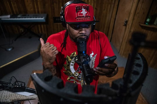 """All right, all right, run that back,"" said Big Trajik, as he records music for his new album at Azmyth Recording Studios, on Wednesday, April 10, 2019. ""OK, now let me punch in right there."""
