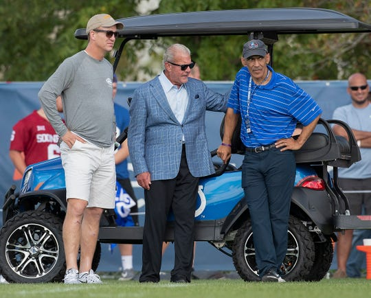 Peyton Manning talks with Indianapolis Colts owner Jim Irsay and former head coach Tony Dungy during their joint practice against the Cleveland Browns at Grand Park in Westfield on Thursday, August 15, 2019.