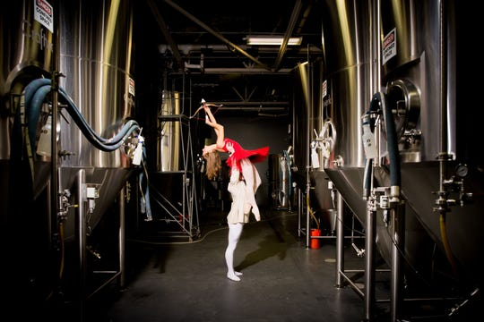 Dancers Christina Presti and Simon Pawlak are pictured in Sun King Brewery before Ballet Theatre of Indiana's Beer & Ballet IV.