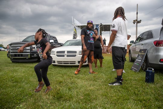 Gia Boyd, 5, dances to a song by Trajik, prior to Trajik's headlining show during Slamology at Lucas Oil Raceway on Saturday, June 8, 2019.