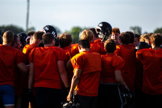 Solon players huddle up after a varsity football practice, Thursday, Aug. 15, 2019, at Spartan Stadium in Solon, Iowa.