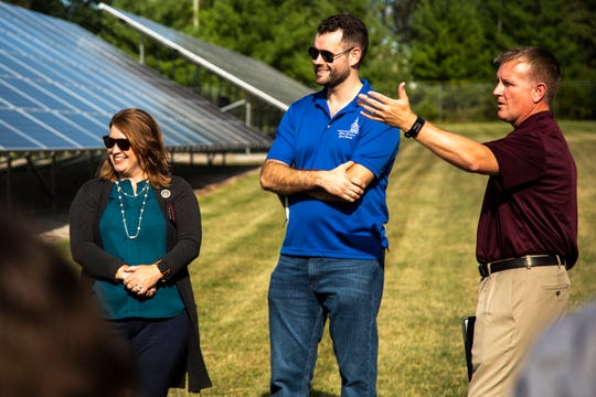 Iowa Sen. Zach Wahls, D-Coralville, and Rep. Lindsay James, D-Dubuque, meet with Chris Hoffman from Moxie, a solar company based in Iowa, Wednesday, Aug. 14, 2019, alongside a 240-panel solar array that powers the Streets Department in North Liberty, Iowa.