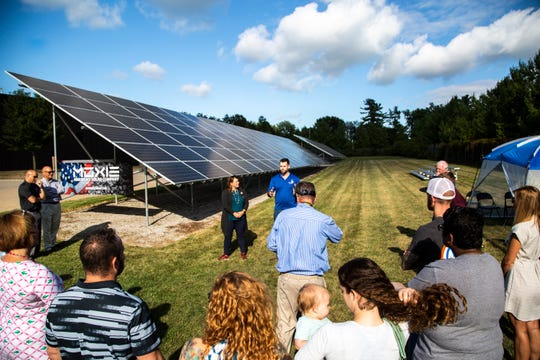 Iowa Sen. Zach Wahls, D-Coralville, and Rep. Lindsay James, D-Dubuque, meet with representatives from Moxie, a solar company based in Iowa, Wednesday, Aug. 14, 2019, alongside a 240-panel solar array that powers the Streets Department in North Liberty, Iowa.