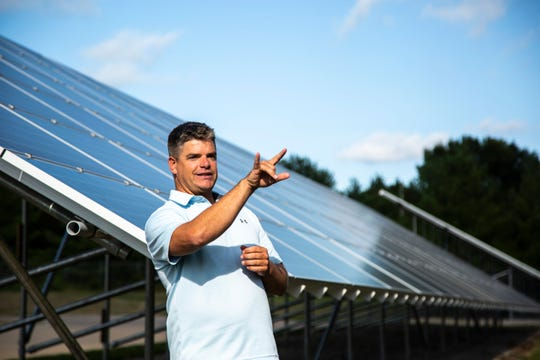 Jason Hall, CEO at Moxie, talks with Iowa Sen. Zach Wahls, D-Coralville, and Rep. Lindsay James, D-Dubuque, Wednesday, Aug. 14, 2019, a 240-panel solar array that powers the Streets Department in North Liberty, Iowa.