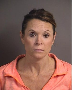 Angela Stull, 42, of Swisher, was arrested after police say she used a credit card, owned by the company she worked for, to make purchases estimated at more than $10,000 from 2017 until February of this year.