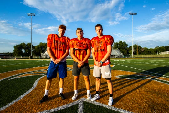 From left, Solon wide receiver A.J. Coons, quarterback Cam Miller and wide receiver Jace Andregg pose for a photo after a varsity football practice Thursday, Aug. 15, 2019, at Spartan Stadium in Solon, Iowa.