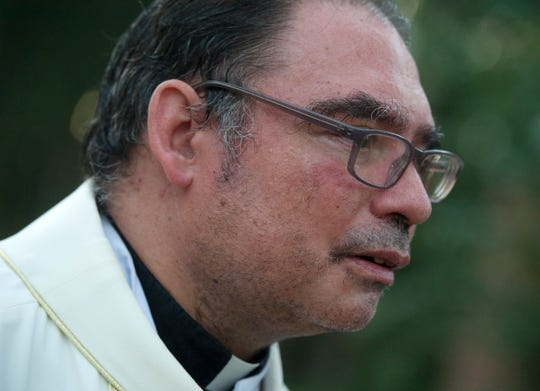 "Since ICE raided Koch Foods and PH Food in Morton on Wednesday, Aug. 7, 2019,  the Rev. Roberto Mena, pastor of St. Michael's Church in Forest, has been fielding constant calls ranging from spiritual support to questions about where to find legal assistance. Just to keep up, ""I've had to charge my phone twice a day,"" he said on Thursday, Aug. 15, 2019."