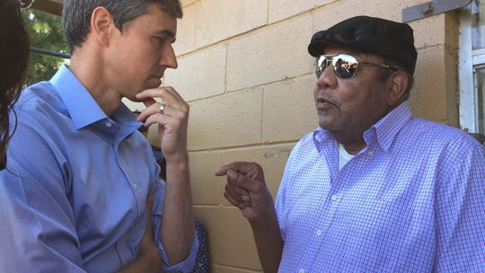 Democratic presidential candidate Beto O'Rourke chats with Louis Haynes during a campaign stop in Canton, Mississippi, on Friday, Aug. 16, 2019.