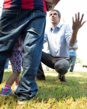 Democratic presidential candidate Beto O'Rourke talks with Latino families during a campaign stop in Canton, Mississippi, on Friday, Aug. 16, 2019.