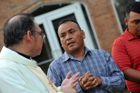 Felix Ramirez, center, and Eduardo Perez, right, both parishioners of St. Michael's Catholic Church in Morton, Miss., discuss the affect the Aug. 7, 2019. ICE raids in Morton have had on their families and the Latino community as a whole.  The Rev. Ricardo Mena, left, pastor at St. Michael's, translates. Ramirez said on Aug. 15, 2019, that he has two nephews that have been detained by ICE authorities, and Perez's wife and sister were detained. Only Perez's wife has been released.