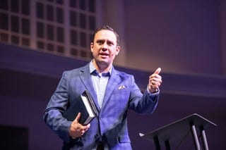 Adam Dooley, seen here during a sermon at Englewood Baptist Church on July 14, will preach his first sermon officially as pastor on Sunday.