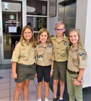 Representing Troop 946, C.C. Berry, Jillian Hartzog, Izzy Shalkowski and Jacey Thomas were among those who attended a special program at Town Hall on Aug. 15. They learned about how our local government works from Mayor Ron Williams.
