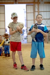 Contestants hold their chickens during the chicken costume contest at the Greene County Fair at the County Fairgrounds in Greeneville on Thursday, July 25, 2019.