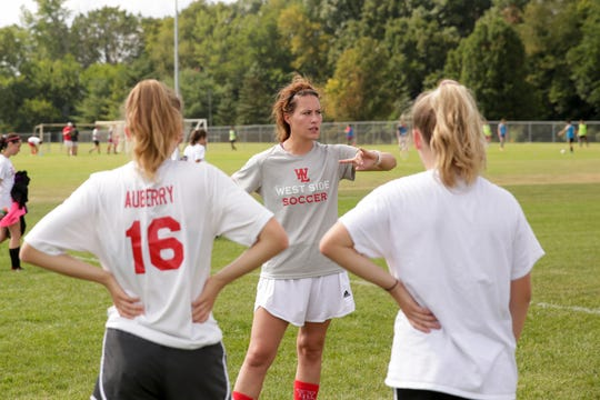 Coach Alyssa Mitchem talks with her offense during a practice, Thursday, Aug. 15, 2019 in West Lafayette.