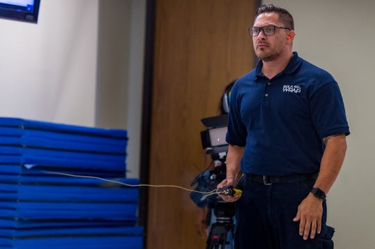 Jeremy Steward, Bola Wrap Technologiesdemonstrates the Bola Wrap 100, a hand-held remote restraint device that discharges an eight foot bola style Kevlar tether to entangle an individual at a range of 10 to 25 feet. Thursday, Aug. 15, 2019.