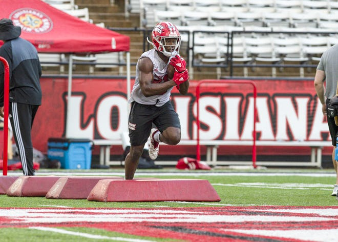 UL running back Chris Smith (21) practices with the Ragin' Cajuns during their football camp Aug. 2. Smith earned  considerable attention making a tackle during the Cajuns' Sun Belt Conference Championship game against Appalachian State last year.