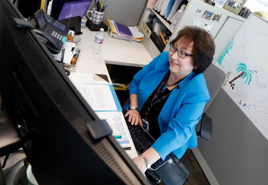Gretchen Epley works at her desk Thursday afternoon, Aug. 15, 2019, at Nationwide Children's Hospital in Columbus. Epley has worked at the hospital for 50 years.