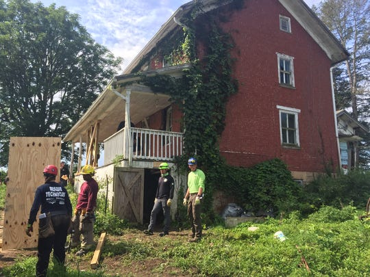 Firefighters in the Bowling Green State University rescue tech program took their final exam in structural collapse at a donated house on Beatty Road in Pleasant Township Thursday.