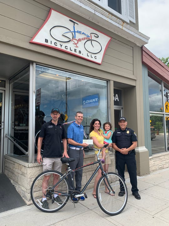Gwen Sukowaty attended the Bicycle Awareness Day event at the Manitowoc Farmers' Market on June 29 and won a free bike from Heavy Pedal Bicycles in Manitowoc.