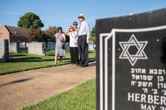 Viewers look on as a 15 foot tall, 8000 pound menorah is installed at Anshei Sphard Cemetery on Friday morning, August 16, 2019.