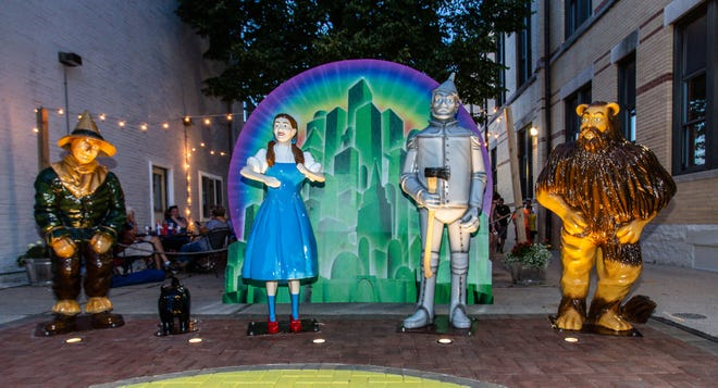 """Statues adorn Oconomowoc's Wizard of Oz Plaza during the 80th anniversary celebration of """"The Wizard of Oz"""" premiere on Thursday, August 15, 2019. City officials are now looking to upgrade the plaza."""