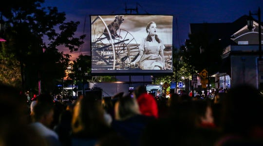 "Thousands of movie-goers fill Wisconsin Avenue in Oconomowoc for the 80th anniversary celebration of ""The Wizard of Oz"" premiere on Thursday, August 15, 2019. The event featured family activities, food, games, costume contests and a screening of ""The Wizard of Oz"" movie on a giant outdoor screen."