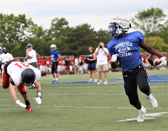 Brookfield Central running back Rashad Lampkin, right, makes a Sun Prairie defender miss and fall to the ground during a scrimmage on August 16, 2019.