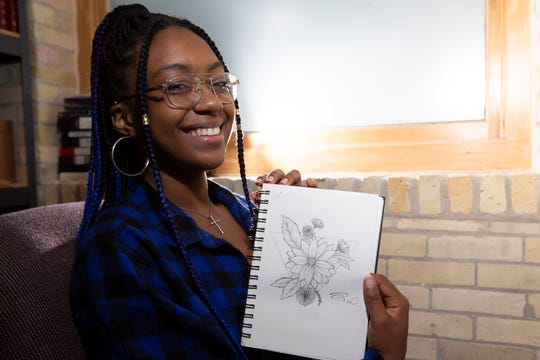 Jayla Washington shows off one of her sketches.