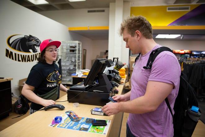 Jake Erickson, a student at University of Wisconsin-Milwaukee, shops in the Panther Shop within the UWM Union building. The store used to have textbooks for sale on its shelves, but the everything has since moved to online ordering.