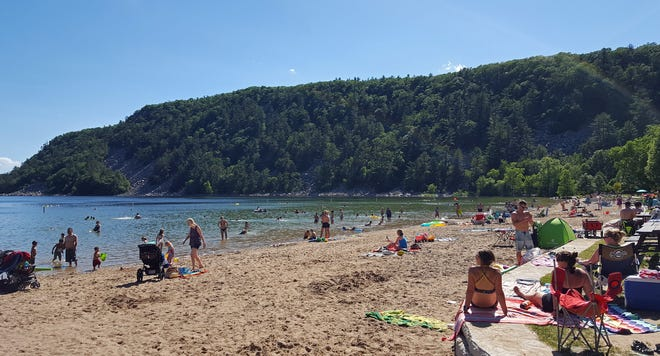 Devil's Lake is Wisconsin's most popular park. The beach on the lake's south shore, pictured here in 2017, is a popular spot for cooling off in the summer.