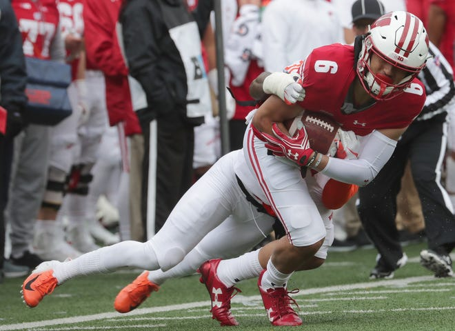 Danny Davis, who was having a solid camp for the Badgers, watched practice from the sideline on Friday in a walking boot after apparently injuring his left foot the day before.