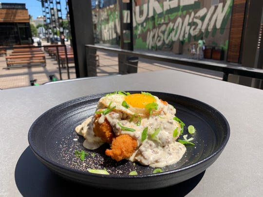 Fried chicken strips, a biscuit, sausage gravy and an egg is one of the breakfasty dishes served at the new brunch at the Mecca Sports Bar and Grill, located off the Fiserv Forum plaza downtown.