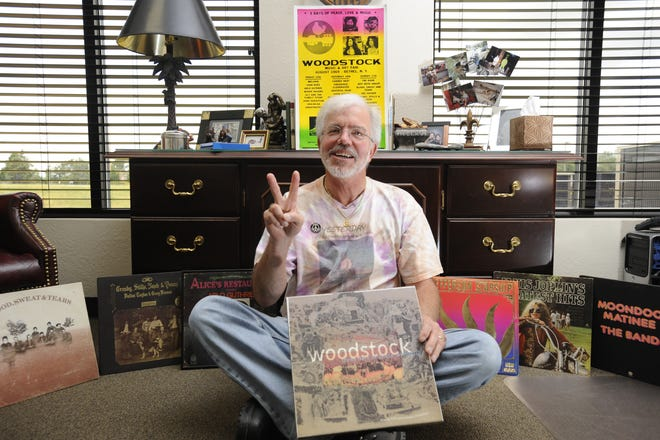 In this Bulletin file photo, George Hill of Mountain Home flashes a peace sign as exhibits some of his Woodstock memorabilia.