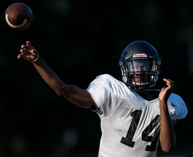 Quarterback Octavius Palmer throws the ball during football practice at Autauga Academy in Prattville, Ala., on Thursday, Aug. 15, 2019.