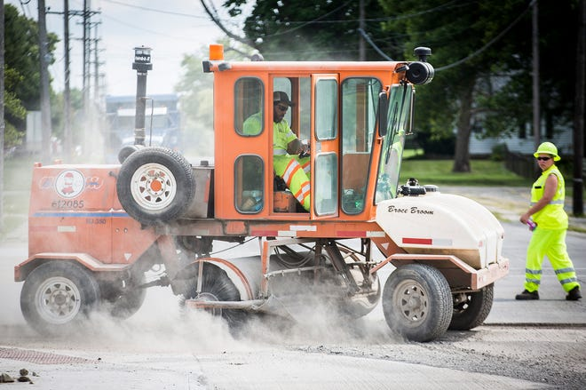 Work on the pavement and sidewalk along East. 26th Street near Southside Middle School is one of the city's few street projects to get under way so far this summer.