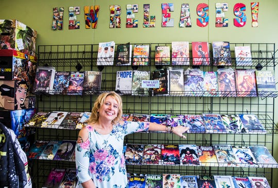 Manager Christian Blanch continued moving inventory into the new Aw Yeah Comics location on Charles Street in downtown Muncie Friday.