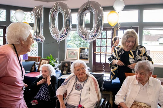 """Sitting from left: Mary Lois Arnold, 103, Amanda """"Opal"""" James, 105, and Marion L. Lyon,104, are honored by the Century Club at The Meadows Lakeshore Senior Living Thursday, Aug. 15, 2019, in Nashville, Tenn."""