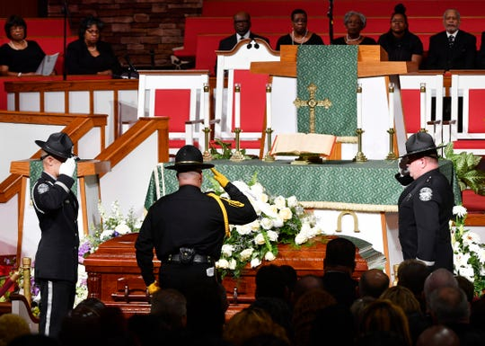 Officers salute the casket during the funeral of Debra Johnson at The Temple Church on Friday, Aug. 16, 2019, in Nashville. Johnson, a Tennessee Department of Correction administrator, was slain Aug. 7.