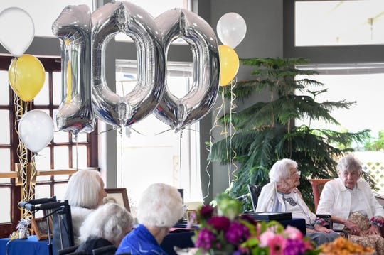 """Amanda """"Opal"""" James, 105, and Marion L. Lyon,104, right, are honored by the Century Club at The Meadows Lakeshore Senior Living Thursday, Aug. 15, 2019, in Nashville, Tenn."""