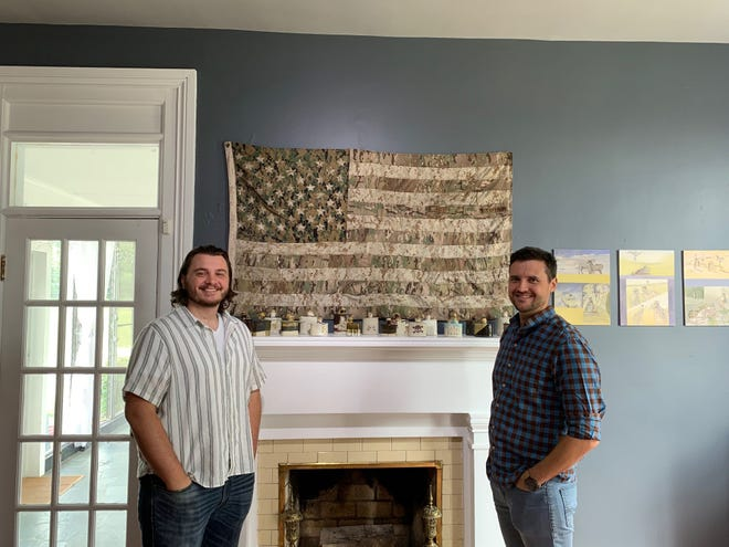 Zachary Burgart (on the right) and Garrett Leo Augustyn (left, Art Director, CreatiVets) took a trip from Chicago to see the CreatiVets art on display at Monthaven.